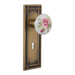 """Nostalgic Warehouse - Nostalgic Mission Plate w/ White Rose Porcelain Knob and Keyhole, Antique Brass - The Mission plate in antique brass harkens to the Spanish Colonial period of the Western frontier, with an instantly recognizable square corner. And, nothing says """"vintage"""" like the traditional floral illustration of the White/Rose Porcelain Knob. All Nostalgic Warehouse knobs are mounted on a solid (not plated) forged brass base for durability and beauty."""