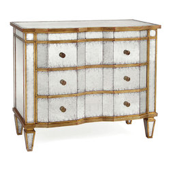 Eglomise Chest of Drawers - Rich and eclectic mixed metals give a chic antiqued shimmer to this lustrous shaped blockfront chest. Antique brass knobs are reflected by aged silver panels of eglomise mirror, which are set between outlines of dark golden gilt. This masterpiece of old-world cabinetry has deep top and bottom molding and stands on tapering pyramid-shaped feet; it serves as a useful and luxurious furniture piece in the bedroom, dining room, or lounge.