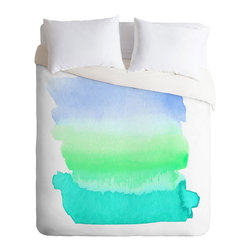Del Mar Morning Duvet Cover - Wash away the day when you lay down under this cozy duvet cover washed over with a soft watercolor splash of beachy hues. Its easygoing blues and greens make it a perfect choice for a light and airy feeling bedroom with a touch of color.