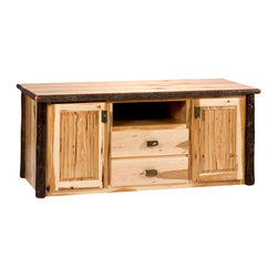 """Hickory Traditional Log Widescreen Television Stand - The Hickory Television Stand is a delightful way to add a rustic touch to your home or cabin. This item is specially crafted with an opening for your VCR DVD player or Satellite/Cable receiver along with two drawers and two cupboards for additional storage. Each piece is individually hand crafted to ensure that it is of the highest possible quality. All Hickory Logs are bark on and kiln dried to a specific moisture content and clear-coat catalyzed lacquer finished for extra durability. Measures 68"""" long 26"""" wide and 28"""" high."""