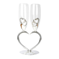 Unik Occasions - Heart Shaped Toasting Glasses - Make your love known with this elaborate and unique pair of champagne glasses! The curved stems create a big and beautiful heart that is decorated with sparkling rhinestones, perfect as a wedding reception accent. The champagne glasses are also accented with two hearts that wrap around the bottom for an extra lovey-dovey touch.