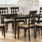 Coaster - Cappuccino Oval Dining Table With Leaf - This entire featured collection is finished in a rich cappuccino. Constructed of solid hardwoods and wood veneer table tops. All chairs shown are of the same finish allowing you to choose the style.
