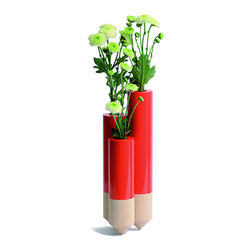Y'A PAS LE FEU AU LAC - Pik Red Vase - The PIK takes its inspiration from a stack, a conical pile of straw, bound up in fields. Simplified as a cylinder ending in a severe cone--creating a juxtaposition of both thick and fine, aggressive and soft, solid and fragile. PIK: three soliflores as three small stacks which, together, stand slightly, delicately, and elegantly.