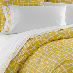 Jonathan Adler Yellow Nixon Duvet Cover in Yellow Nixon - It's sunny. It's bold. It's literally how we feather our nests (with down feathers). This duvet cover and related bedding from Jonathan Adler are an inspiring jumping off point for how you decorate your boudoir.