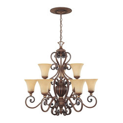 Designers Fountain - Designers Fountain 81589 Montreaux 9 Light Chandelier in Burnished Walnut with G - Shop for Chandeliers from Hayneedle.com! Evoking the romantic charm and opulent elegance of Victorian aesthetics the Designers Fountain 81589 Montreaux 9 Light Chandelier in Burnished Walnut with Gold Finish stands out in any setting. Intricate details in the center column are matched by graceful exquisitely scrolled arms each of which displays a delicate Navajo dust glass shade. The multi-step burnished walnut finish with gold accents plays up the sweep of the curves creating a 2-tier fixture that will be the highlight of your foyer or formal dining space. Nine 100-watt incandescent medium base bulbs (not included) emit a glow of soft light that's just what you need for atmospheric dining or entertaining. A timeless design exuding old world aesthetics this stately chandelier comes with a decorative medallion and 10 feet of chain for installation.About Designers FountainHeadquartered in sunny Los Angeles Designers Fountain lets you show off your creative side. Indulge yourself and your home with a range of lighting styles from contemporary to classic each crafted with care from high-quality materials. Designers Fountain supplies lighting fixtures to over 1 200 authorized North American dealers and sources designs from across the world. Get quality lighting that enhances your home while impressing you with its affordable price... only from Designers Fountain.