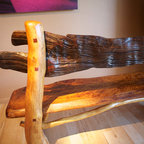 Penelope Bench detail - The bench seen in the photograph has a mesquite back shown here. What is so fascinating about this is that that piece of mesquite is over 250 years old. I found a stack of mesquite in an old barn and it was gray and dusty. Purchased it and discovered how beautiful it was. See the twisty flowing grain?