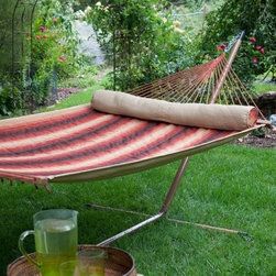 Island Bay Dura-Weave Quilted Hammock with Faux Woodgrain Stand - Additional features: Stand dimensions: 13 - 15 ft. L x 4 ft. W x 3 ft. 9 in. H Dura-Weave fabric is water- mildew- and UV-resistant for lasting use 100% FSC-certified wood spreader bars UV-resistant polyester rope Hanging distance min/max: 13 ft./16 ft. Zinc-plated hanging hardware included Hammock comes with an FSC-certified hang tag Nothing encourages you to relax and soak in the summer sunshine more than the Island Bay Dura-Weave Quilted Hammock with Faux Woodgrain Stand. Made of soft, yet extremely durable water- mildew- and UV-resistant Dura-Weave fabric that will offer years of enjoyment, this hammock also scores high in the comfort factor. You'll be enveloped in such luxury, thanks to the soft fabric and the coordinating bolster pillow, that you might find yourself spending more time outdoors than you've ever done before! Choose from several striped patterns to brighten up your outdoor setting. Responsibly harvested Forestry Stewardship Council (FSC)-certified spreader bars hold the hammock open for easy getting in and out. It has a weight capacity of 450 pounds and the dimensions of the bed itself are 6 feet 8 inches in length and 4 feet 6 inches in width. Boasting a faux woodgrain look that is weather- and rust-resistant, the heavy-duty, 14-gauge steel stand is built to offer years of style and function. One of our most beloved hammocks, the Island Bay Dura-Weave Quilted Hammock has constantly topped our customer favorite list. Taking a cue from that, we've paired this hammock with one of our sturdiest, most trusted hammock stands, so you can enjoy your new hammock immediately and start making the most of summer! When it comes to relaxing and unwinding in style, you can't go wrong with this cool, comfy hammock set! About Dura-Weave Equivalent to well-known Sunbrella fabrics in durability and weather-resistance, Dura-Weave textiles consist of 100% solution-dyed polyester with an impressively long, colorfast life. Designed for those who want the softness and comfort of cotton with the strength of polyester, Dura-Weave rope and quilted hammocks offer exceptional quality at a much more economical price than similar quality hammocks. Rigorous testing has proven Dura-Weave's ability to withstand fading, tearing, rubbing, weathering, and even melting. You can count on Dura-Weave to be extremely UV-resistant - this textile has 1000 hours of colorfastness. Dura-Weave quilted and rope hammocks are mildew-resistant, and water repellent. They won't snag, tear, or wear out easily, and they're age-resistant. Dura-Weave is a textile you can count on to look good and stay strong season after season. About Island Bay HammocksIsland Bay Hammocks come to you directly from skilled hammock artisans, and feature the Island Bay logo on the spreader bar. Using the latest technology alongside time-tested traditional methods of construction, these hammocks are woven with the pride of their makers.