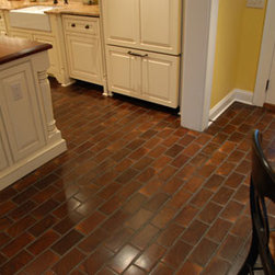 End Grain Flooring - Reclaimed wood surfaces and red brick flooring make a pretty pair.