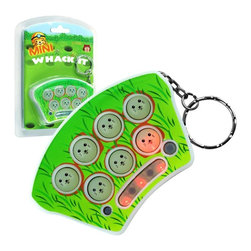 Trademark Global - Mini Whack It Toy Game w Sound and Lights - Batteries and retail packaging included. Travel sized. Sound and mute functions. Three difficulty levels or three speeds. Life energy meter. Off button. Requires three LR44 batteries. For ages 5 and up. Made from plastic. No assembly required. 2.88 in. W x 0.75 in. D x 1.88 in. H (1 lbs.)Now you can enjoy big arcade fun in a convenient travel size with Mini Whack It. Three levels of game play increase difficulty as you progress and are sure to test your reflexes. Improve hand eye coordination, relieve stress and enjoy this entertaining game wherever you go.