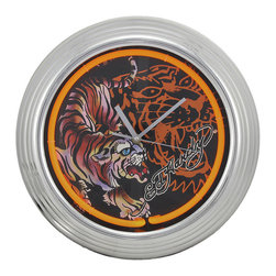 Ed Hardy `Crouching Tiger` Tattoo Neon Wall Clock - This officially licensed Ed Hardy `Crouching Tiger` neon wall clock is perfect for use in home bars, bedrooms and dorm rooms. The clock features a retro chrome frame, bright yellow neon surrounding the clock face, and has gold tone hands. The neon is powered by the included AC plug, and the clock is powered by a single AA battery. The clock face measures 10 inches in diameter, and the chrome frame is 14 1/2 inches in diameter. It makes a great gift for Ed Hardy fans.