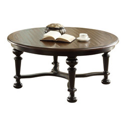 Riverside Furniture - Riverside Furniture Williamsport Round Cocktail Table in Nutmeg/Kettle Black - Riverside Furniture - Coffee Tables - 92603 - Riverside's products are designed and constructed for use in the home and are generally not intended for rental commercial institutional or other applications not considered to be household usage.