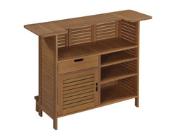 HomeStyles - 52.5 in. U-Shaped Bar - Durable and natural water resistance. Utility drawer. Open doors to storage area. One adjustable shelf. Open storage area with adjustable shelves. Made from eco-friendly shorea wood. Eucalyptus finish. 52.5 in. W x 21 in. D x 43.5 in. H. Warranty. Assembly InstructionsCreate an island oasis in your own backyard with Home Styles montego bay outdoor bar cabinet. Plantation grown Shorea wood which is known for its exceptional durability and natural resistance to water. This bar cabinet is designed to provide endless hours of outdoor entertainment use.