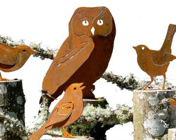 Rustic Metal Cut-Outs Bird Silhouettes (Large) - Stately barn owls with heart shaped faces, majestic peregrine falcons, the long legged, long necked wonder of waterfowl, the Great Blue Heron. Statement making big birds roost here. The smallest measures 12 inches from beak to tail feather while the largest – a cock's comb crested rooster – stands a statuesque 17.5 inches tall. Designed and crafted to represent their standard poses, the birds flat bases allow you to mount them where appropriate outdoors or perch them on a table or mantel. Nothing says literati like a raven on a bookshelf of Edgar Allen Poe novels.