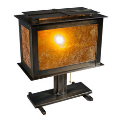 American FABHOUSE - Craftsman Table Lamp Harmony - Finished with a golden mica and set in a black steel frame, the uniquely styled Craftsman Table Lamp draws the eye and illuminates softly. The metal fabrication, while it offers a nod to traditional styling, provides updated accents while the granular nature of the glass shade diffuses light. 1 - 40 watt bulb included