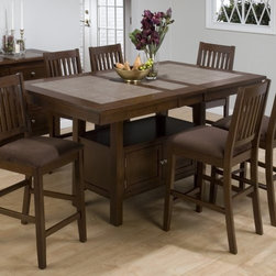 "Jofran Trumbull Tile Top Counter Height Storage Dining Table - Give your decor a boost with the Trumbull Tile Top Counter Height Storage Dining Table. A counter height table with ample storage space the Trumbull makes any dining room or kitchen feel complete. Its Asian hardwood construction and round terra tile surface really put the Trumbull table in a league of its own. Measures 48L x 48W x 36H inches. This purchase is for table only please see """"Related Items"""" for matching chairs or complete dining set. About Jofran FurnitureJofran is a seller of fine home furnishings based in Norfolk Mass. Launched In 1986 Jofran is known for the high-quality materials and meticulous methods that go into producing its products. Jofran furniture is easy-to-assemble and includes various styles from all around the world making it easy to find a piece that suits your home decor."