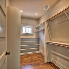 Traditional Closet by Indie Capital
