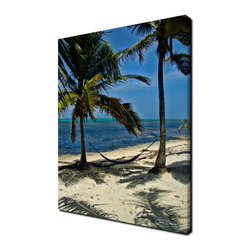 Ready2HangArt - Ready2hangart 'Maya Hammock' Canvas Wall Art - The 'Maya Hammock' canvas art depicts a peaceful setting of a hammock between two palms on a clear and sunny days, the palms resting overhead creating shade and shadows. This canvas features a tropical theme and is gallery-wrapped canvas for a contemporary look.