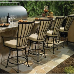 O.W. Lee Monterra Barstool - Set of 4 - Providing a unique design with guaranteed comfort for four, the O.W. Lee Barstool - Set of 4 makes a lovely addition to any outdoor living space. Each deep seating barstool offers simple sophistication with luxury and style. The stools are hand-crafted from wrought iron, and boast hammered rivets at key intersections, along with embossed flat bars which envelop the cushioning of the chair. Speaking of cushioning, durable Sunbrella cushions are available in your choice of color, allowing you to seamlessly complement your existing decor. They are fade- mildew-, stain-, and water-resistant as well as easy to clean with mild soap and water. Dimensions: 42.5W x 39D x 43.5H inches. Please note: This item is not intended for commercial use. Warranty applies to residential use only.Materials and construction:Only the highest quality materials are used in the production of O.W. Lee Company's furniture. Carbon steel, galvanized steel, and 6061 alloy aluminum is meticulously chosen for superior strength as well as rust and corrosion resistance. All materials are individually measured and precision cut to ensure a smooth, and accurate fit. Steel and aluminum pieces are bent into perfect shapes, then hand-forged with a hammer and anvil, a process unchanged since blacksmiths in the middle ages.For the optimum strength of each piece, a full-circumference weld is applied wherever metal components intersect. This type of weld works to eliminate the possibility of moisture making its way into tube interiors or in a crevasse. The full-circumference weld guards against rust and corrosion. Finally, all welds are ground and sanded to create a seamless transition from one component to another.Each frame is blasted with tiny steel particles to remove dirt and oil from the manufacturing process, which is then followed by a 5-step wash and chemical treatment, resulting in the best possible surface for the final finish. A hand-applied zinc-rich epoxy primer is used to create a protective undercoat against oxidation. This prohibits rust from spreading and helps protect the final finish. Finally, a durable polyurethane top coating is hand-applied, and oven-cured to ensure a long lasting finish.About SunbrellaSunbrella has been the leader in performance fabrics for over 45 years. Impeccable quality, sophisticated styling and best-in-class warranties prove the new generation of Sunbrella offers more possibilities than ever. Sunbrella fabrics are breathable and water-repellant. If kept dry, they will not support the growth of mildew as natural fibers will. Beautiful and durable, Sunbrella is a name you can trust in your outdoor furniture.Cleaning and Caring for SunbrellaRegular maintenance is the best way to keep your Sunbrella fabrics looking good and delay deep, vigorous cleaning. Brush off dirt before it becomes embedded in the fabrics, and wipe up spills as soon as they occur. For light cleaning, use a mild soap and water solution and a sponge, allowing your cleaning solution to soak into the fabric. Rinse thoroughly to remove all soap residue and allow fabric to air dry.About O.W. Lee CompanyAn American family tradition, O.W. Lee Company has been dedicated to the design and production of fine, handcrafted casual furniture for over 60 years. From their manufacturing facility in Ontario, California, the O.W. Lee artisans combine centuries-old techniques with state-of-the-art equipment to produce beautiful casual furniture. What started in 1947 as a wrought-iron gate manufacturer for the luxurious estates of Southern California has evolved, three generations later, into a well-known and reputable manufacturer in the ever-growing casual furniture industry.
