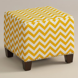 """World Market - Yellow Zigzag McKenzie Ottoman - Cozy up with our custom-made Ash Zigzag McKenzie Ottoman, handcrafted in the U.S.A. with cotton upholstery and nail head trim. Showcasing a lively yellow and white chevron print, this plush ottoman makes a bold statement. Pair two ottomans for a dramatic """"bench"""" at the foot of the bed. Shop our coordinating bed or headboard in the same custom fabric for a pulled together look."""