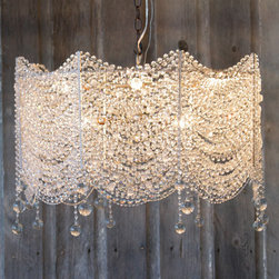 Fabian Chandelier - What's not to love about this chandelier? It is so beautiful, it would definitely make a huge impact in any room.