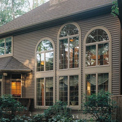Replacement Windows - A total home transformation with the addition of new replacement windows here. With ROI climbing steadily each year, this investment was truly worth it. And your neighbors are seriously jealous