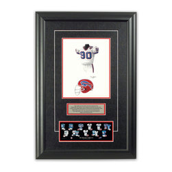 """Heritage Sports Art - Original art of the NFL 1990 Buffalo Bills uniform - This beautifully framed piece features an original piece of watercolor artwork glass-framed in an attractive two inch wide black resin frame with a double mat. The outer dimensions of the framed piece are approximately 17"""" wide x 24.5"""" high, although the exact size will vary according to the size of the original piece of art. At the core of the framed piece is the actual piece of original artwork as painted by the artist on textured 100% rag, water-marked watercolor paper. In many cases the original artwork has handwritten notes in pencil from the artist. Simply put, this is beautiful, one-of-a-kind artwork. The outer mat is a rich textured black acid-free mat with a decorative inset white v-groove, while the inner mat is a complimentary colored acid-free mat reflecting one of the team's primary colors. The image of this framed piece shows the mat color that we use (Red). Beneath the artwork is a silver plate with black text describing the original artwork. The text for this piece will read: This original, one-of-a-kind watercolor painting of the 1990 Buffalo Bills uniform is the original artwork that was used in the creation of this Buffalo Bills uniform evolution print and tens of thousands of other Buffalo Bills products that have been sold across North America. This original piece of art was painted by artist Tino Paolini for Maple Leaf Productions Ltd. Beneath the silver plate is a 3"""" x 9"""" reproduction of a well known, best-selling print that celebrates the history of the team. The print beautifully illustrates the chronological evolution of the team's uniform and shows you how the original art was used in the creation of this print. If you look closely, you will see that the print features the actual artwork being offered for sale. The piece is framed with an extremely high quality framing glass. We have used this glass style for many years with excellent results. We package every piece"""