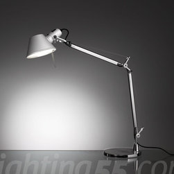"""Artemide - Tolomeo Mini table lamp - 20% smaller than the Tolomeo Classic • choice of table mounting in polished die-cast aluminum: - 8"""" round table base - table clamp (2"""" max. clamp opening) - table in-set support (requires a 3/4'' dia. hole and supports 2.5"""" max. depth) • fully adjustable, articulated arm body structure in extruded, brilliant, natural anodized aluminum • joints, tension control knobs and mountings in polished die-cast aluminum • tension cables in stainless steel • 6"""" diameter diffuser in stamped, anodized matte aluminum, tiltable and 360 degree rotatable on lampholder with incorporated on/off switch • U.L. listed"""