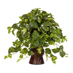 Nearly Natural - Pothos w/Bamboo Vase Silk Plant - The Pothos is a beautiful plant that is certain to add a real spark of life to any room that it inhabits.  With its crisp, plentiful leaves that seem to flow from everywhere, this is a plant that will be a sight that any plant lover will appreciate.  Housed in a wonderful bamboo vase, this Pothos is a plant that will bring a calming sense of fulfillment to your daily life.