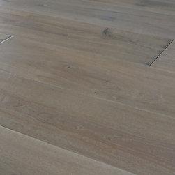 French Cut White Oak Plank - Our Custom Prefinished Hand-scraped European/French cut White Oak Plank Flooring.