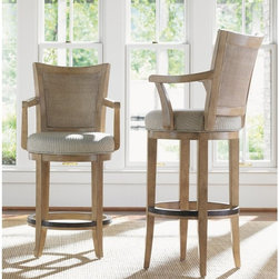 Lexington Home Brands - Lexington Home Brands Monterey Sands 30 in. Carmel Swivel Bar Stool Multicolor - - Shop for Stools from Hayneedle.com! Sophisticated and luxurious the Lexington 30 in. Carmel Swivel Bar Stool is a beautiful and comfortable addition to your dining room. Designed to impress and inspire this gorgeous stool features a stunning woven split rattan back with an elegant graceful curve. The Grey Elm veneer is gently brushed to highlight the grain lines of the wood and then finished in a sandy brown that is glazed in oyster white. Curving arms softens the linear design of this stool and brings out the gorgeous transitional design. Inspired by the understated style of the West Coast this stool has an extremely comfortable cloth sandy brown seat with a woven design that blends in seamlessly with the wood. A metal rim on the circular stretcher not only protects the wood but also gives you leverage to swivel your chair so you can engage in different conversations. Whether you're dining with friends or family this beautiful stool will ensure your comfort throughout the meal and afterwards. Please note: This item is not intended for commercial use. Warranty applies to residential use only. Additional Features Extremely comfortable design Gracefully curved arms softens the linear design Metal rim on circular stretcher helps protect wood Swivel design makes it easy to move Gorgeous wood construction Blends natural materials and light wood tones Inspired by the understated style of the West Coast Clean lines and elegant simplicityAbout Lexington Home BrandsFounded in 1903 in High Point NC Lexington Home Brands has become a globally known manufacturer and marketer of unique home furnishings. They are an industry leader in design style and quality products. Their product line consists of upholstered and hardwood furniture under recognized brands such as Lexington Tommy Bahama Sligh and Henry Link Trading Co.. Lexington Home Brand's intentions and aspirations are 