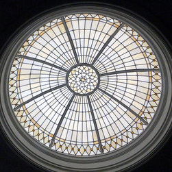 Decorative Leaded Glass Ceiling Domes - This is a 6.5'dia x 2' ht. leaded glass dome and features a custom painted frame. The opalescent glass was specially ordered directly from Kokomo, and each jewel was sandblasted and hand painted on the reverse side in order to soften the appearance. A very subtle classic dome.