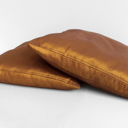 Bolo Silk Pillow - Fine silk, superb workmanship and iconic Ayers design come together to form this Bolo Silk Pillow. Unique seamless style makes the Bolo perfect atop a chair or bench. From the front, there is no visible seam, and from either side there is a distinct almond eye to give detail and interest.