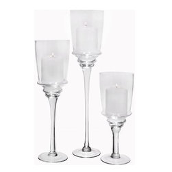 """Home Essentials - Clear Glass Straight Hurricane Candle Set - The glow of the candlelight seems extra special in this set of three hurricane holders. Decoratively crafted of clear glass, these three hurricane holders can be grouped together or used separately, creating a rich ambiance on your dining table or mantle. Our simple hurricanes keep flames protected while letting romantic candlelight shine through.                                          * Dimensions: 12"""", 16"""", and 20"""" Tall"""