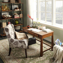 None - Bramwell Warm Walnut 1-drawer Writing Desk - This beautiful Bramwell writing desk features timeless elegance with a modern accent. With a slim shape, tapered legs, and sizable drawer space for ample storage, this warm walnut finished desk is versatile enough to complete any room in your home.