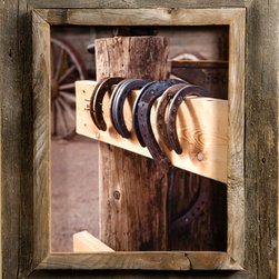 MyBarnwoodFrames - 12x12 Western Picture Frame Western Rustic Narrow Width 2.25 inch  Siz - Western  Picture  Frame          A  Western  Picture  Frame from mybarnwoodframes.com  makes  a  great  gift  for  any  western  decor  enthusiast.  If  you  love  the  look  of  barnwood,  you'll  be  glad  to  know  that  ours  is  100%  authentic,  manufactured  here  in  the  Great  American  West  by  Mother  Nature  herself. You  can  bring  the  air and  sunshine  right  inside  your  home  with  one  of  our  beautiful  and  unique  rustic  frames.                While  it  isn't  practical  to dismantle  the  weathered  barn  and  bring  it  indoors,  you  can  still  enjoy  the  look  of  the  beautiful  weathered  wood  with  a  cowboy  frame  handcrafted  right  here  in  the  American  West.  Each  of  our  western rustic  frames  cases  a  .75 inch  plank  edge  inside  a  1.5  inch  barwood  frame.  This  frame-inside-frame  look  lends  itself  especially  well  to cowboys,  ranches,  and  other  western subject  matter.   We  offer  the  frame  in  two  widths.            Here's  the  perfect western  picture  frame  for  a  herd  of  wild  mustangs in  the  redrock  desert,  a photo  of  your son's  first  pony,  or  a  painting  of  a  stand  of  Chapparal.  The  unique  casing  also  makes a cowboy  frame a  great  choice  if  you  want  to  leave  the  glass  out  and  create  a  shadowbox  frame  for  a  pair  of  antique  spurs, a  poster  of  your  favorite  national  park, of  a few  shards  of  Native  American  pottery. We  offer  western  picture  frames  in  several  widths,  and  you  can  even  find  a  few  with  western  embellishments like  barbed  wire  and  iron.  This  is  authentic  western  rustic  decor  at  its  best.            Click  here  to  view  our  entire  inventory  of  Western  and  Cowboy  Frames          Product  Specifications:                    Frame  is  crafted  from  authentic  barnwood                Frame  width:   2.25  inches                12x12  photo  opening                Exterior  dimensions  approximately  17x17              Add  glass  or  plexiglas  if  desired              Hanging  hardware  is  included.  Hang  horizontally  or  vertically