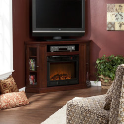 Holly & Martin™ Ponoma Convertible Media Electric Fireplace-Cherry - Holly & Martin™ Ponoma Convertible Media Electric Fireplace-Cherry has a triangular media storage shelves on either side of the firebox provide plenty of space for your favorite media selections and are enclosed by glass doors. An additional media equipment shelf rests above the firebox and is complete with convenient back wall cord access. This particular fireplace mantel is also designed with a collapsible panel, allowing for versatile placement against a flat wall or corner in your home.