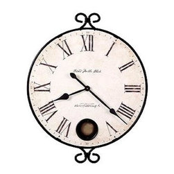 """Howard Miller - Howard Miller - Magdalen Wall Clock - Piquant wrought iron styling wraps around the Monticello wall clock with double whorls at top and bottom.  Face is antiqued with fade-resistant ink and inset peephole shows pendulum movement.  Sweeping spade-style hands are accurate and decorative.  A great fit for many types of decor.  This clock is framed in wrought iron and has an antique brass pendulum for good measure. * Antique dial framed in wrought iron, with a pendulum peep hole. The pendulum is finished in antique brass. Has crackle dial and aged spade hands. Battery operated quartz  movement. Height 32-3/4"""" (83cm), Width 26-1/4"""" (67cm), Depth 2-1/4"""" (6 cm)"""