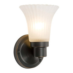 Design House - Design House 505115 Single Light Up / Down Lighting Village Wall Sconce with Fro - Single Light Up / Down Lighting Village Wall Sconce with Frosted Flute Glass from the Wall Sconce CollectionThe Design House 505115 Village Vanity Wall Sconce, part of the Village Collection, is simple and affordable with a well-built design. This fixture features a single light, an oil rubbed finish and a frosted flute. This product is designed for indoor lighting and blends traditional aesthetics with the latest trends in interior design. Providing your home with warm nurturing light, this product keeps bedrooms and dining areas well lit. With glare-free illumination and spot-on color rendition, this light is perfect for your bathroom or lavatory. This light meshes modern aesthetics with industry leading features and offers safe, glare-free light. The oil rubbed bronze finish adds warmth to any room and the simple design matches any decor. This collection is available in a wide range of styles to accent any room or home decor. This light is perfect for hallways, bedrooms and dining areas and is a beautiful accent to any wall. The oil rubbed bronze finish adds a touch of warmth to any room. This product uses (1) 60-watt bulb (not included) and is UL listed to ensure the highest quality possible. The fixture has a wall mount and a back plate that is 4.5-inches in diameter and can be mounted up or down. The Design House 505115 Village Vanity Wall Sconce comes with a 10-year limited warranty to the original purchaser to be free from defect in materials and workmanship. With a strong corrosion resistant finish, this product attests to the quality of all Design House products, and integrates traditional curves with the amenities of industry leading features. Design House offers products in multiple home decor categories including lighting, ceiling fans, hardware and plumbing products. With years of hands-on experience, Design House understands every aspect of the home decor industry, and devotes itself to providing quality products across the home decor spectrum. Providing value to their customers, Design House uses industry leading merchandising solutions and innovative programs. Design House is committed to providing high quality products for your home improvement projects.Features: