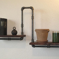 Industrial Plumbing Pipe Shelf by Vintage Pipe Dreams - I think this definitely qualifies as vintage industrial. The pipes are softened by the beautiful walnut wood, and these would be a conversation starter in any home.