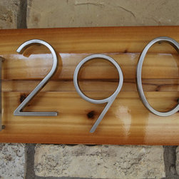 Custom Address Sign by Daddy's Simple Signs - This cedar plank and metal numbers address sign is more suitable for a modern house.