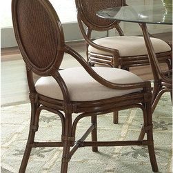 Hospitality Rattan - Hospitality Rattan Oyster Bay Side Chair with Cushion - TC Antique Multicolor - - Shop for Dining Chairs from Hayneedle.com! The herringbone-woven wicker of the Hospitality Rattan Oyster Bay Side Chair with Cushion - TC Antique is the perfect complement to a body of sturdy curved rattan poles. The antique finish gives it a deep chocolatey color that can easily complement most home decor styles while the neutral-toned seat cushion adds the kind of comfort that will let you relax here for hours.About Hospitality Rattan Hospitality Rattan has been a leading manufacturer and distributor of contract quality rattan wicker and bamboo furnishings since 2000. The company's product lines have become dominant in the Casual Rattan Wicker and Outdoor Markets because of their quality construction variety and attractive design. Designed for buyers who appreciate upscale furniture with a tropical feel Hospitality Rattan offers a range of indoor and outdoor collections featuring all-aluminum frames woven with Viro or Rehau synthetic wicker fiber that will not fade or crack when subjected to the elements. Hospitality Rattan furniture is manufactured to hospitality specifications and quality standards which exceed the standards for residential use. Hospitality Rattan's Environmental Commitment Hospitality Rattan is continually looking for ways to limit their impact on the environment and is always trying to use the most environmentally friendly manufacturing techniques and materials possible. The company manufactures the highest quality furniture following sound and responsible environmental policies with minimal impact on natural resources. Hospitality Rattan is also committed to achieving environmental best practices throughout its activity whenever this is practical and takes responsibility for the development and implementation of environmental best practices throughout all operations. Hospitality Rattan maintains a policy of continuous environmental improveme