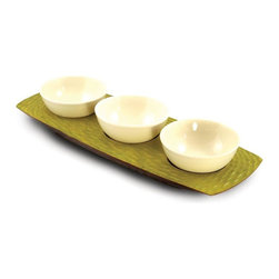 Enrico - Casual Dining Wood Serving Tray with 3 Ceramic Bowls - Hand-carved. Ceramic bowls are removable and dishwasher safe. Food safe finish can be hand washed and cleans up easily. Made from environmentally-friendly reclaimed mango wood. Avocado and lacquer finish. Made in Thailand. 18 in. L x 7 in. W x 3 in. H (4 lbs.). Interior damp rated for use. Warranty: 90 days limited. Casual dining collectionThe 3 Bowl Server is perfect for a salsa bar, salad dressing assortment, taco ingredients, or to dish up three kinds of snacks on the coffee table. Each piece is hand-carved by skilled artisans, so no two are exactly alike. Colors may vary slightly due to natural construction. Each item in the Mango Honeycomb Brick grouping is an enigmatic and tactile Avocado honeycomb texture carved into the outer surface and a smooth interior. These stylish bowls and trays are carved from mango trees grown in Thailands vast mango plantations. The Mango tree bears fruit for about 20 to 30 years, after which time it is cut down by the farmer to make room for new seedlings. The creamy, dense mango wood is then reclaimed by local craftsmen for carving into a wide variety of beautiful products. The artisans working mango wood pay careful attention to the individuality of each and every raw slab of wood that comes into their hands, and the results are wonderful. Each piece in this collection has a live edge of contrasting tree bark around the rim which reminds one that each tree has a character and texture all its own.