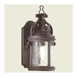 Troy Lighting - Pamplona Outdoor Wall Mount by Troy Lighting - The Troy Lighting Pamplona Outdoor Wall Mount is hand-crafted by expert artisans designed to add a rustic and romanticized appearance to your decor. The Pamplona Outdoor Wall Mount features Clear Seeded glass shade, hand-forged iron body and Old Bronze finish. Troy Lighting, headquartered in California, designs and manufactures indoor and outdoor lighting fixtures, utilizing hand-forged iron and hand-applied finishes to create quality products with high-style appeal.