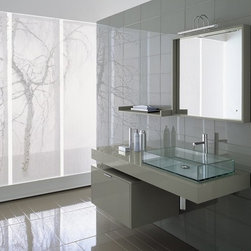 """Cosmopolitan - Modern Bathroom Vanity Set 55"""" - Cosmopolitan is a modern bathroom vanity set that embraces the latest thinking in modern bathroom design.  Visually striking, the glass bento vessel sink offers an architectural grace and presence. The rectangular form of the vessel offers a long flat basin; when filled, it offers the serenity and beauty of a reflecting pool. A wonderful basin that creates a Zen-like water feature.  The faucet rises from the thick rubber wood counter frame at the back of the basin and reaches over the sink. The released water crashes into the flat basin before going down the long slim drain."""