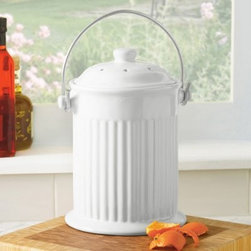 White Ceramic Compost Crock - Clean and simple in appearance, the White Ceramic Compost Crock can sit right on your countertop while you fill it with fruit and vegetable scraps and other food trimmings. Having this pail so easily in reach makes natural recycling a hassle-free effort. Simply toss in your coffee grinds, fruit and veggie peels, and more, and when you're ready, just empty the crock into your larger compost pail or pile. This crock holds several days' worth of food trimmings. To keep odors locked in while the compost crock sits in your kitchen, dual charcoal filters fit neatly inside the lid and last from two to six months, depending on use. The snug fitting lid keeps odors from escaping, and the large handle makes it easy to carry this pail from one spot to another. It's dishwasher safe so cleaning is easy. A replacement set of charcoal filters is also included.Please note this product does not ship to Pennsylvania.