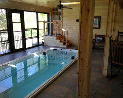 Endless Pools - 17' Endless Pool® Swim Spa - The wood grain, the marble's swirls and veins, the water's ripples ... we love the rustic vibe of this Endless Pool Swim Spa installation.
