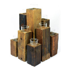 Staggered Pillars, 9 Lights - The Unysyn Elm Staggered Pillars cluster tealight candles in an engaging display. Gathered together, the rectangular Chinese elm stands remind one of the beauty of a forest, simplistic and complex all at once. It has a patina finish from the age of the wood. The repurposed timbers of the Unysyn Elm Staggered Pillars make candlelight a piece of art.