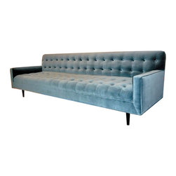 M|n Originals Tufted sofa - A contemporary French sofa. So chic and so inviting. The color and the tufts are quite lovely indeed.