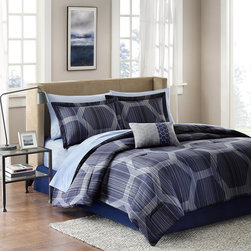 Madison Park Essentials - Madison Park Essentials Rincon Complete Bed and Sheet Set - Rincon has a modern urban look with a geometric print. The dark blue face is covered in navy blue hexagons with subtle blue and gray stripes that add texture to this comforter. Made from microfiber polyester and is machine washable for easy care. The complete bed set includes one embroidered decorative pillow which features a bold blue stripe, one standard sham, and a coordinating blue sheet set. Comforter & Sham: micro fiber 85gsm print on face, micro fiber 85gsm solid reverse Filling: 250g/m2 polyester Bedskirt: micro fiber 85gsm Sheet sets: 100% cotton 180TC print Pillow: polyester cover and polyester filling