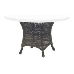 Woodard - Woodard Serengeti Wicker Dining Table Base - One of Woodard�s most unique collections is the Serengeti including the stationary lounge patio chair the Serengeti ottoman and the Serengeti wicker patio swivel rockers among so many other available pieces. The feeling is pure creature comfort and so is the craftsmanship. The Serengeti collection including the patio sofa gliding loveseat stationary lounge patio chair Serengeti ottoman and the popular Serengeti wicker patio swivel rocker is made from All Seasons Wicker that has been hand woven over exceptionally strong aluminum frames. You won�t find better quality and workmanship than with Woodard guaranteed.The easy-maintenance wicker coupled with the wide variety of fabric and chair tie options in colors and designs will keep your deck or patio busy with entertaining your friends family co-workers or just the two of you well past sunset. Enjoy the carefree feeling that the Serengeti collection evokes and put your feet up on the Serengeti ottoman while you sink into the stationary lounge patio chair in well-deserved comfort.The name Woodard Furniture has been synonymous with fine outdoor and patio furniture since the 1930s continuing the company�s furniture craftsmanship dating back over 140 years. Woodard began producing hand-made wrought iron furniture which led the company into cast and tubular aluminum furniture production over the years.� Most recently Woodard patio furniture launched its entry into the all-weather wicker furniture market with All Seasons which is expertly crafted and woven using synthetic wicker supported by an aluminum frame.� The company is widely known for durable beautiful designs that provide attractive and comfortable outdoor living environments.� Its hand-crafted technique used to create the intricate design patterns on its wrought iron furniture have been handed down from generation to generation -- a hallmark of quality unmatched in the furniture industry today. With deep seating slings and metal seating options in a variety of styles Woodard Furniture offers the designs you want with the quality you expect.  Woodard aluminum furniture is distinguished by the purest aluminum used in the manufacturing process resulting in an extremely strong durable product which still can be formed into flowing shapes and forms.� The company prides itself on the fusion of durability and beauty in its aluminum furniture offerings. Finishes on Woodard outdoor furniture items are attuned to traditional and modern design sensibilities. Nineteen standard frame finishes and nineteen premium finishes combined with more than 150 fabric options give consumers countless options to design their own dream outdoor space. Woodard is also the exclusive manufacturer of outdoor furnishings designed by Joe Ruggiero home decor TV personality.� The Ruggiero line includes wrought iron aluminum and all weather wicker designs possessing a modern aesthetic and fashion-forward styling inspired by traditional Woodard patio furniture designs. Rounding out Woodard�s offerings is a line of distinctive umbrellas umbrella bases and outdoor accessories.� These offerings are an integral part of creating a complete outdoor living environment and include outdoor lighting and wall mounted or free standing architectural elements � all made with Woodard�s unstinting attention to detail and all weather durability. Woodard outdoor furniture is an American company headquartered in Coppell Texas with a manufacturing facility in Owosso Michigan.� Its brands are known under the names of Woodard Woodard Landgrave and Woodard Lyon Shaw. With a variety of collections Woodard produces a wide array of collections that will be sure to suit any taste ranging from traditional to contemporary and add comfort and style to any outdoor living space. With designs materials and construction that far surpass the industry standards Woodard Patio Furniture creates beauty and durability that is unparalleled.